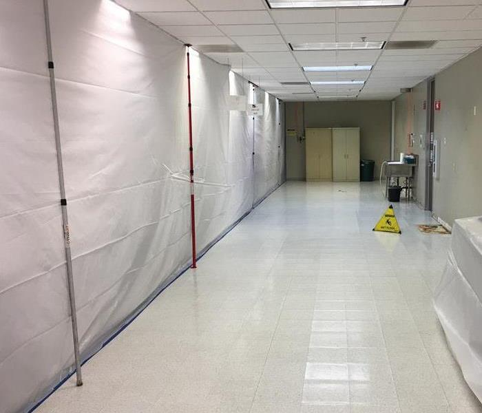 Containment wall setup to prevent medical equipment from contamination